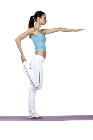 Woman on a yoga posture with her right leg bend and left arms stretch on the front