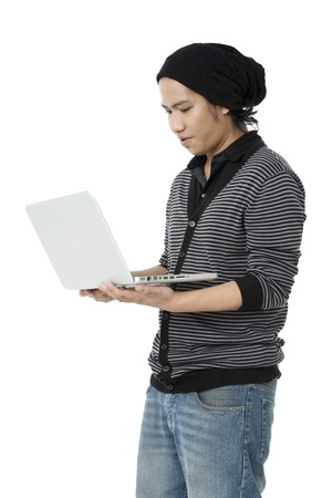 pinoy: Side view of a boy surfing net on laptop. Model: Jomarie Nepomuceno