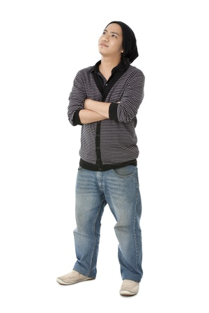 pinoy: Image of a boy in casual clothing wearing skull cap with arms crossed and looking up.