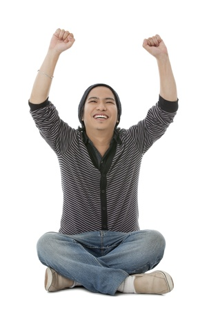 Portrait of happy young guy raising his arms isolated on white background photo