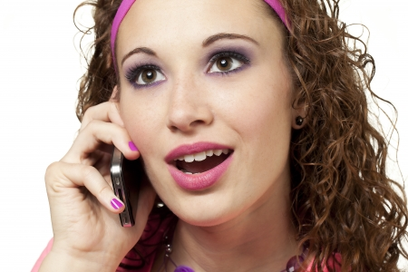 Girl dressed in 80's chic retro clothing talks on cell phone. Makeup by Irene Prowell - professional freelance makeup artist. Stock Photo - 17482606