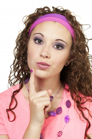 Straight shot of girl on 80's garg with her finger on her chin. Makeup by Irene Prowell - professional freelance makeup artist. Stock Photo - 17482601