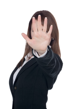 Caucasian businesswoman putting her hand on front to say stop photo