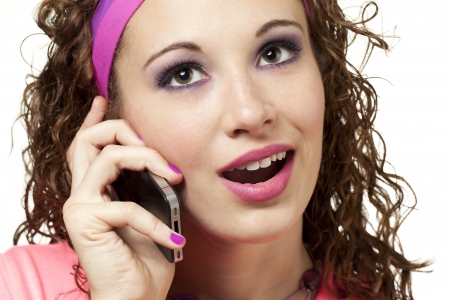 Young lady dressed in neon talks on the phone. Makeup by Irene Prowell - professional freelance makeup artist. Stock Photo - 17482600