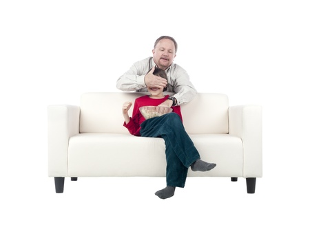 Image of father and son making fun to each other sitting in the couch Stock Photo - 17492819