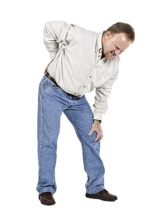 spinal conditions: Image of aged man having back pain against white background Stock Photo