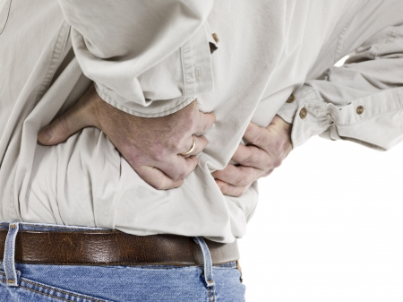 Close up image of aged man having back pain against white background photo