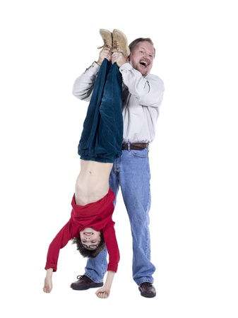 knee bend: Image of a grandfather having a fun bonding with his grandson isolated on