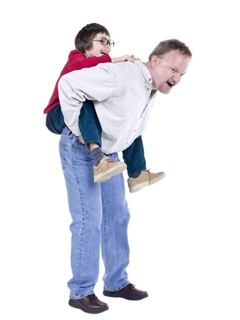 grand father: Portrait of a happy mature man giving his grand child a piggy back ride Stock Photo