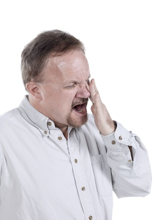 impaired: Old man holding his aching eye isolated in a white background Stock Photo