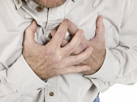 Image of an old man holding his chest suffering from the heart attack Stock Photo