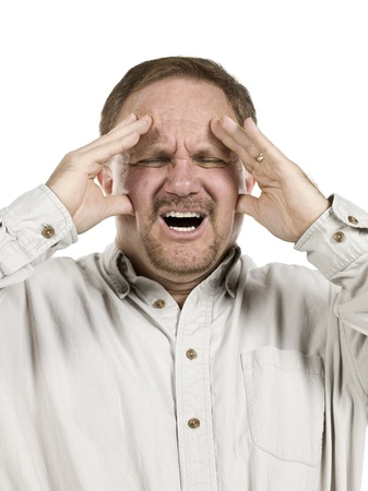 Close-up image of an old man suffering from a head ache against the white background Stock Photo - 17493012