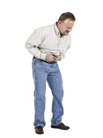 dolor de estomago: Imagen de un anciano que sufre de dolor de est�mago mientras est� de pie sobre un fondo blanco Foto de archivo