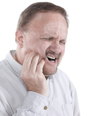 Old man suffering toothache isolated in a white background photo