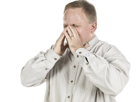 Image of an old man having a sinus against white background photo