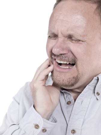 Close-up image of a senior man having a toothache isolated against the white background Stock Photo - 17492975