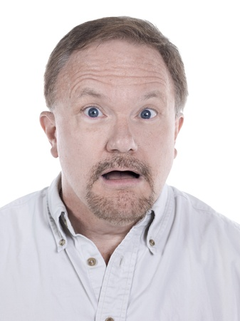 Closed up portrait of a surprised old man isolated in a white background photo