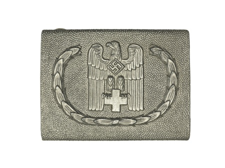 Close-up shot of a silver German army belt buckle with eagle and swastika sign on it. Stock Photo - 17493108