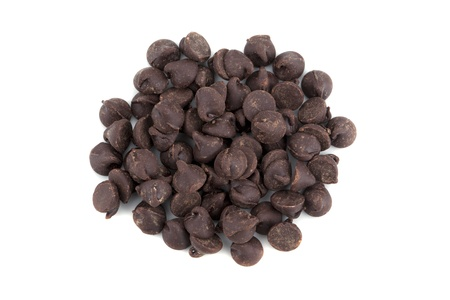 A pile of chocolate chips on a white background photo