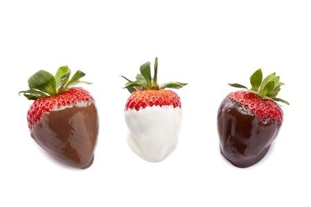 chocolate candy: Horizontal image of a ripe strawberries in different dipped against white background