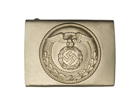 Close-up shot of a World war two German belt buckle with eagle and swastika on it. Stock Photo - 17493113
