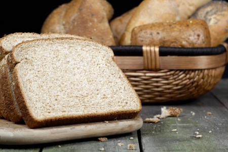 Image of a slice bread on a wooden table Stock Photo - 17493125