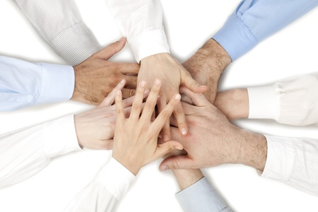 Image of a group of people on a handshake over the white background Stock Photo - 17493013