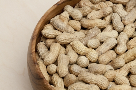 earthnuts: Close up image of bowl of dry peanuts Stock Photo