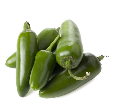 Close up image of bunch of green jalapeno peppers against white background photo