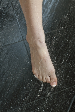 flowing water: Close-up image of cleaning foot under the shower Stock Photo