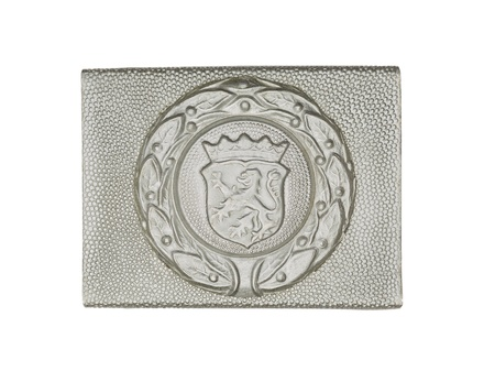 Close-up shot of a silver German military belt buckle with lion representation on it. Stock Photo - 17488015