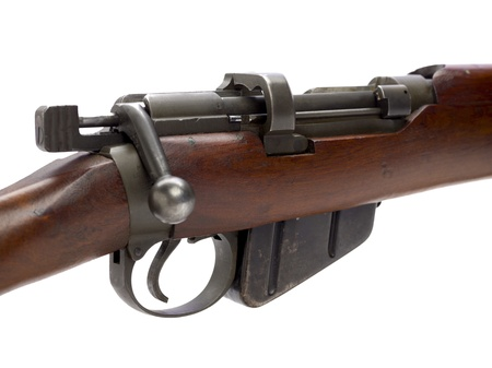 riffle: Close view of rifle against white background