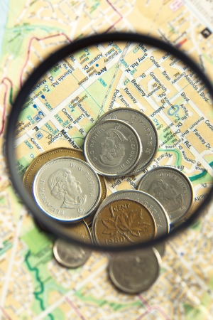 Coins and world map with magnifying glass Stock Photo - 17487272