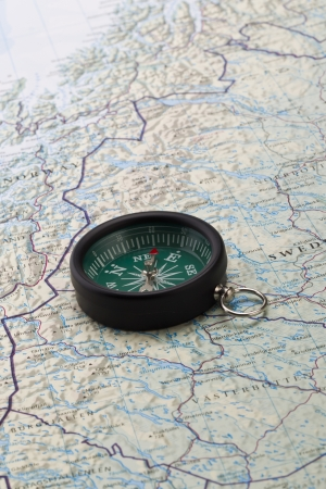 Portrait image of a compass with the world map on the background Stock Photo - 17488271
