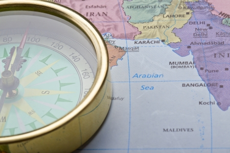 destin: Cropped close up image of compass on map