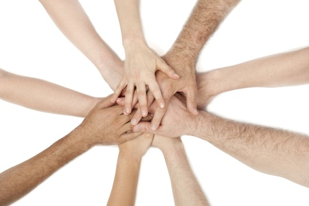 coalition: Diverse group of people holding hands together isolated on a white background