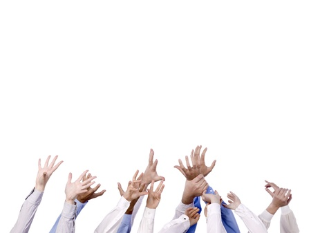 grasp: Close  up image of diverse hands reaching in the air against white background Stock Photo