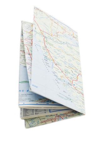 Close up image of a folded map against white background photo
