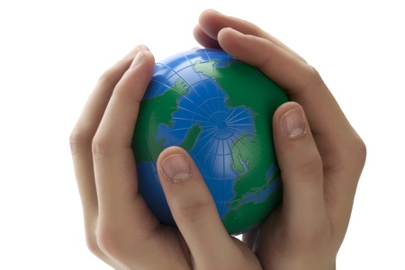 Close up image of  a human hands holding a globe photo
