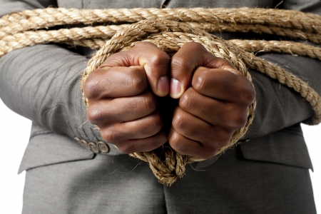 Close up image of human hand tied up with rope photo