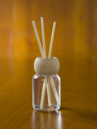 Closed up shot of wooden sticks in an empty incense bottle use in spa Banco de Imagens