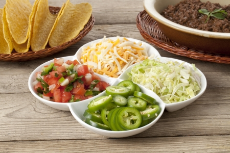 totopos: Close-up image of ingredients in making Mexican taco over the wooden table Stock Photo