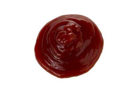 tomato catsup: Drop of ketchup over a white surface