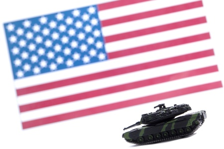 Image of a military tracked vehicle in front of USA flag isolated against the white background Stock Photo