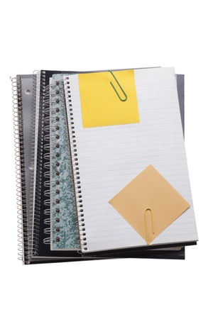 Image of colorful notebooks with sticker and paper clips over the white background photo