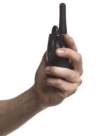 cb: Close-up image of a human hand holding portable cb radio
