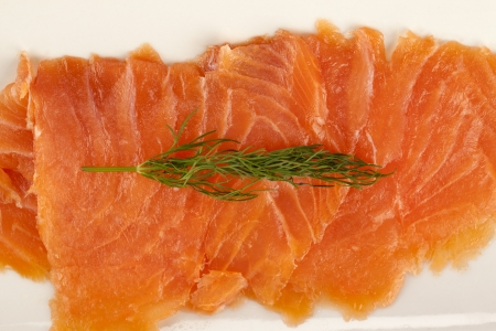 Close up image of slices of delicious smoked salmon photo