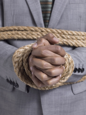 Closeup shot of a businessman tied with rope Stock Photo - 17488766