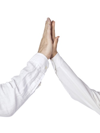 stipulation: Close up image of two hands high five against white background Stock Photo