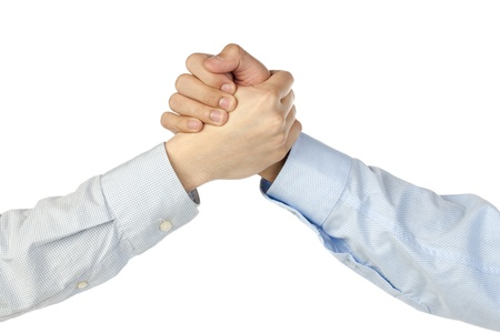 Close-up image of two business people having a hand shake over the white background Banco de Imagens